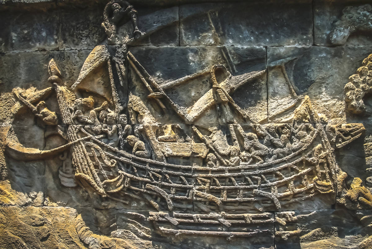 Sailing ship sculpted and carved on the wall in the Borobudur temple in Java, Indonesia